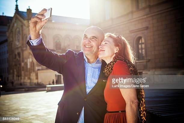Senior couple taking a self portrait, Munich, Bavaria, Germany