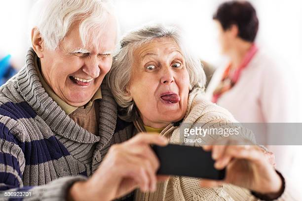 Senior couple taking a selfie.