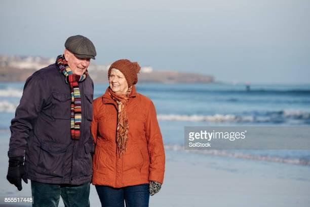 Senior Couple Taking a Walk Along the Beach