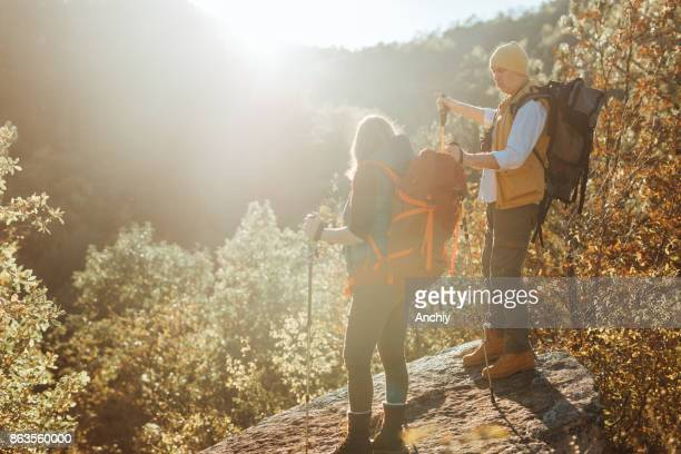 senior couple taking break from their hike in the nautre - nautre stock pictures, royalty-free photos & images