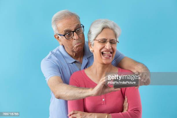 senior couple taking selfie - naughty wife stock photos and pictures