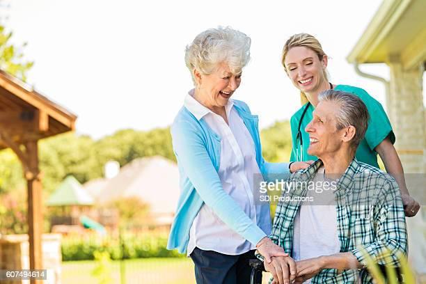 Senior couple talk with home healthcare nurse