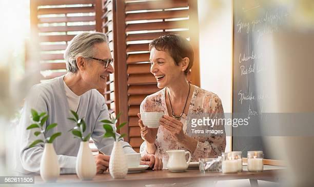 Senior couple talking at restaurant