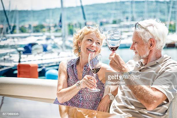 Senior couple toasting on a yacht