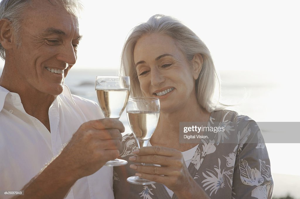 Senior Couple Toasting Wine Glasses : Stock Photo