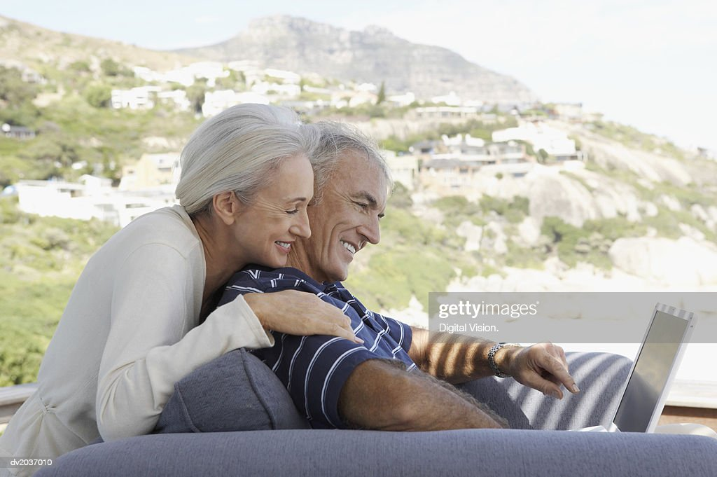 Senior Couple Using a Laptop Computer : Stock Photo