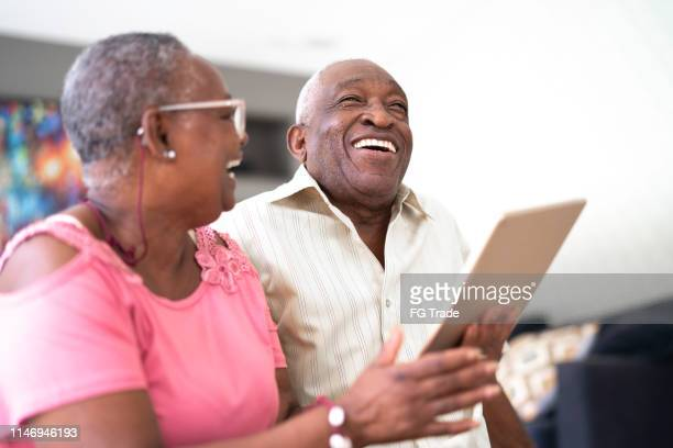 senior couple using digital tablet - facetime stock pictures, royalty-free photos & images