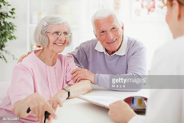 Senior couple visiting doctor.