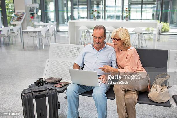 Senior couple waiting in airport