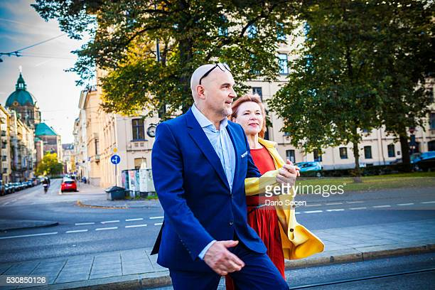 Senior couple walking along city street, Munich, Bavaria, Germany