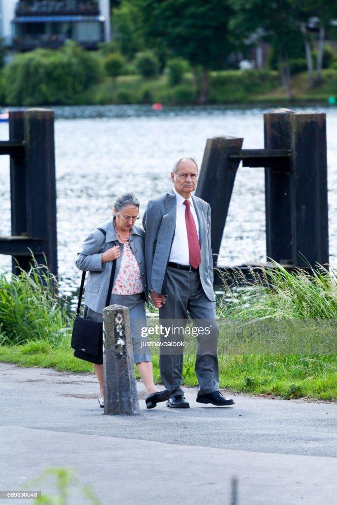 Senior couple walking along Ruhr : Stock Photo