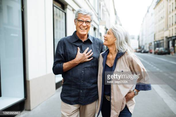 senior couple walking around the city - life insurance stock pictures, royalty-free photos & images
