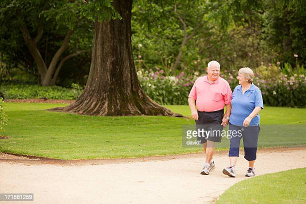 Senior Couple Walking in a Park