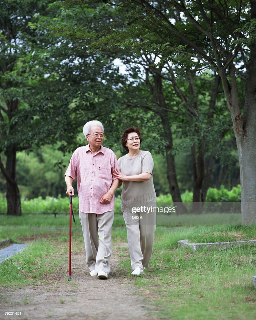 Senior couple walking in a park : Stock Photo