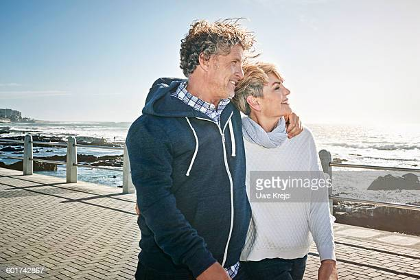 Senior couple walking on promenade
