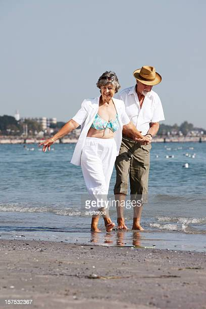 senior couple walking on the beach - old man feet stock pictures, royalty-free photos & images