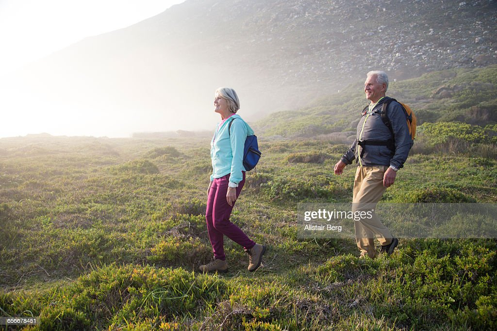 Senior couple walking outdoors together : Stock Photo
