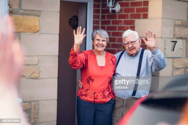 Senior Couple Wave Goodbye