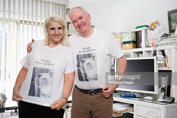 Senior couple wearing anniversary shirts