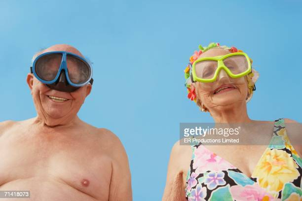 Senior couple wearing goggles and bathing suits