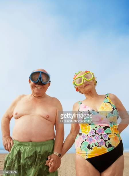 Senior couple wearing goggles at the beach