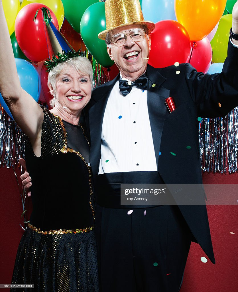 Senior Couple Wearing Party Hats Celebrating New Years Eve ...