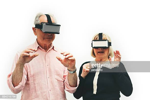 senior couple wearing virtual reality headset, paris, france - 21st century stock pictures, royalty-free photos & images
