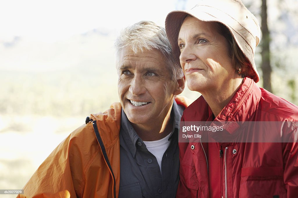 Senior Couple Wearing Weather Proof Clothing and Standing Together : Stock Photo