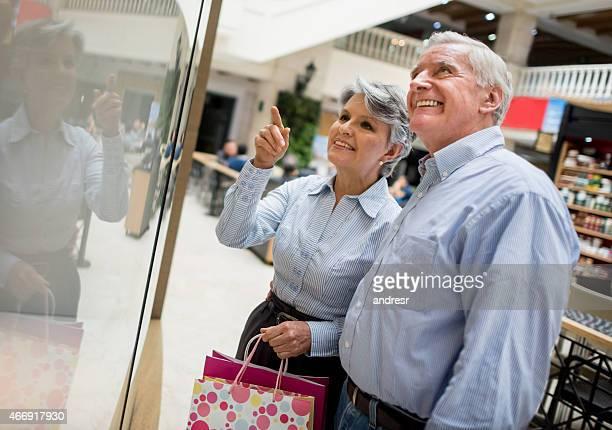 Senior couple window shopping