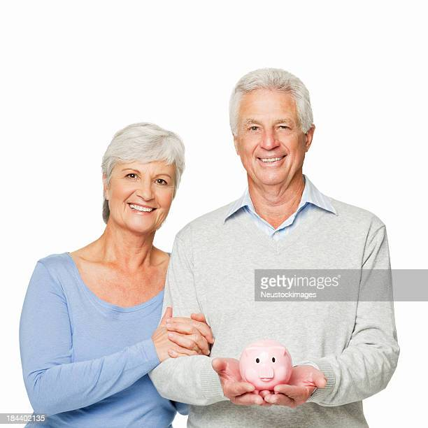 Senior Couple With a Piggy Bank - Isolated