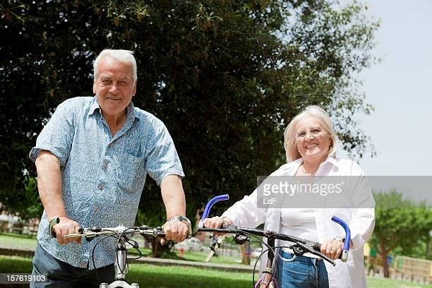 Senior couple with bicycles in a park