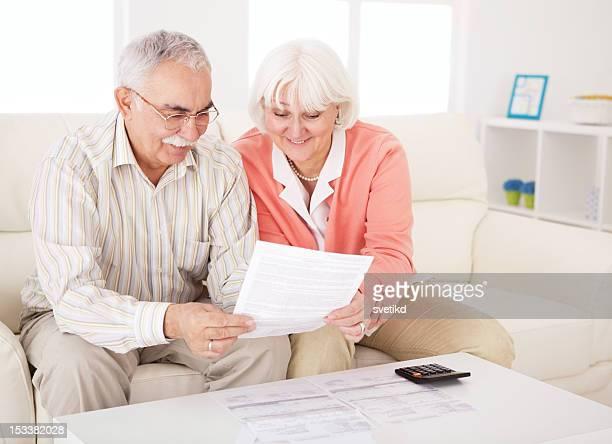 Senior couple with bills.
