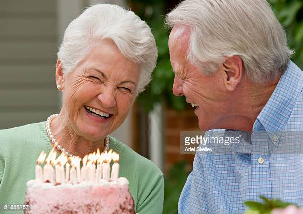 senior couple with cake - anniversary stock pictures, royalty-free photos & images