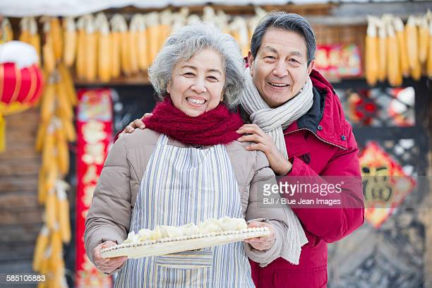 Senior couple with Chinese Dumplings