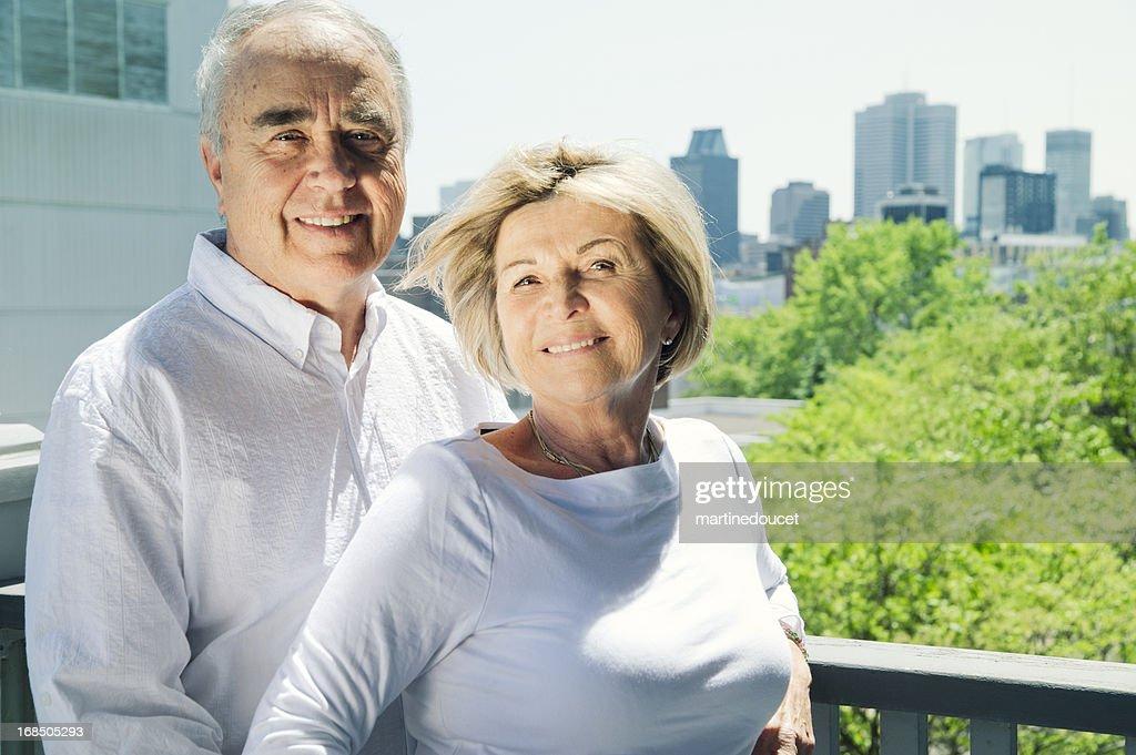 Senior couple with city background. : Stock Photo