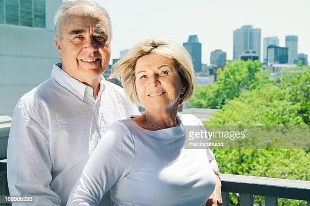 Senior couple with city background.