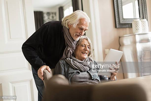 Senior couple with digital tablet