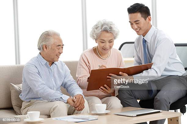 Senior couple with financial consultant