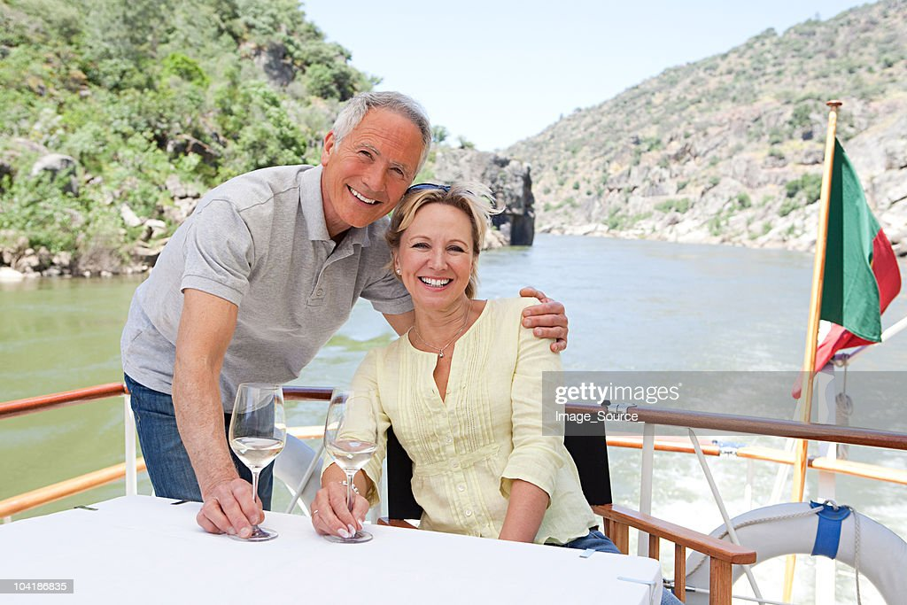 Senior couple with glasses of wine on a boat holiday : Stock Photo