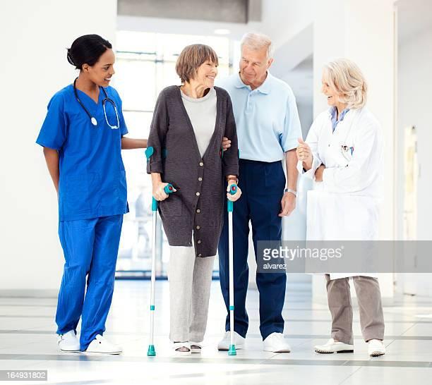 Senior couple with hospital staff