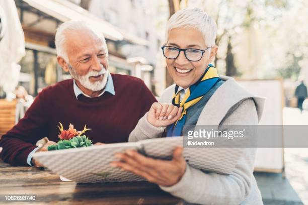 senior couple looking at menu restaurant