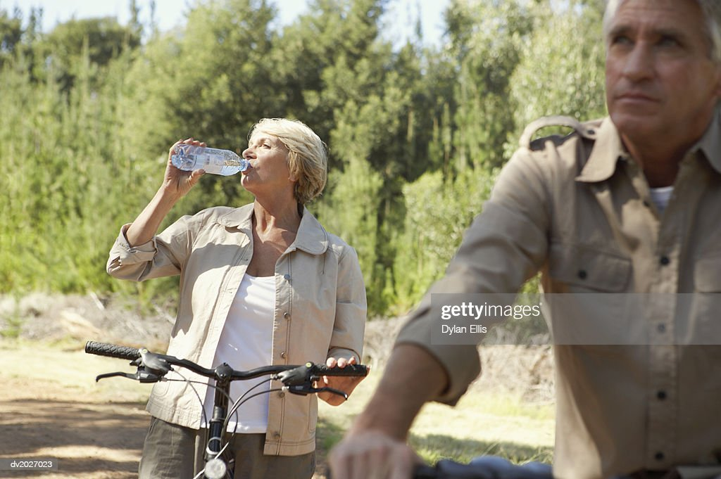 Senior Couple With Their Bicycles in the Countryside : Stock Photo