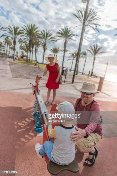 Senior couple with their grandsan at the playground