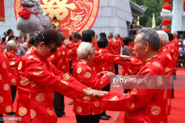 101 senior couples celebrate their 50th anniversaries one day before the Qixi Festival the Chinese Valentine's Day at Laojun Mountain on August 16...