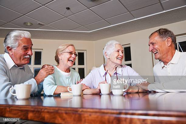 Senior couples drinking coffee