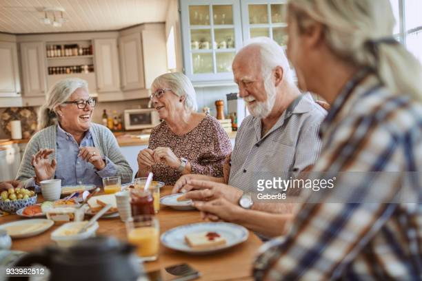 Senior couples having breakfast