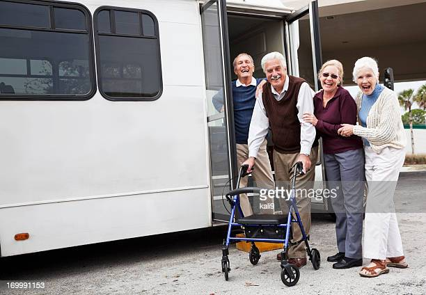 senior couples outside shuttle bus - van vehicle stock pictures, royalty-free photos & images