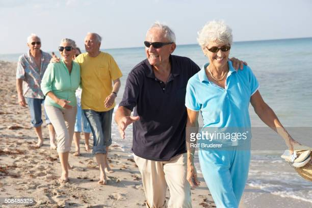 Senior couples walking on beach