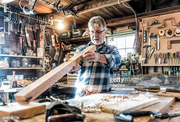 senior craftsman working in traditional workshop - shed stock pictures, royalty-free photos & images