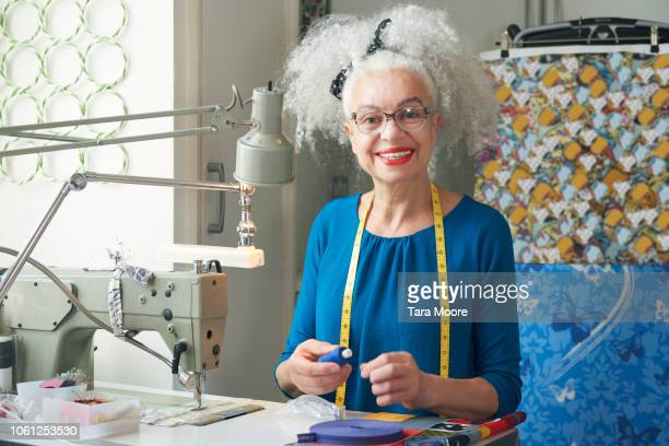 senior creative woman working from home - hobbies stock pictures, royalty-free photos & images